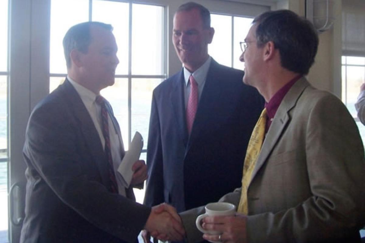 April 5, 2012 Selectman Rick Murray and Harbormaster Mark Patterson greet Lt. Go